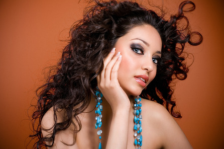 blue hair: Beautiful woman with long curly hair.