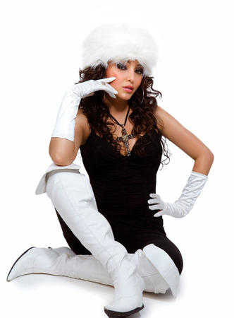 women in boots: Model wearing white boots, gloves and fur hat. Stock Photo
