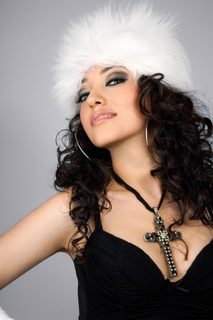 white fur: Model wearing white fur hat.