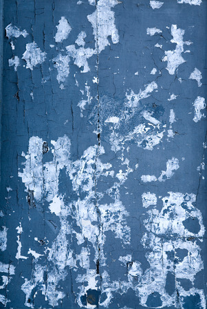cruddy: Blue old ripped door texture with spots.