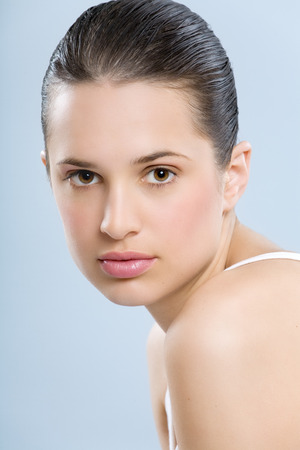 glowing skin: Beautiful young European woman with fresh smooth glowing skin. Stock Photo