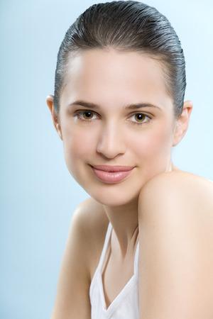 Beautiful young European woman with fresh smooth glowing skin. Banco de Imagens