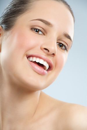 glowing skin: Beautiful young European woman with fresh smooth glowing skin and healthy white teeth.