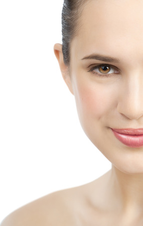 glowing skin: Beautiful smiling European girl with fresh smooth glowing skin and pink lipstick. Stock Photo