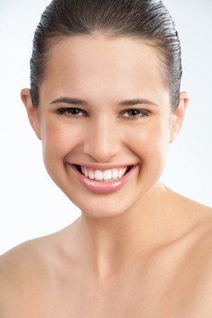 glowing skin: Beautiful young European woman with fresh tanned glowing skin and healthy white teeth.