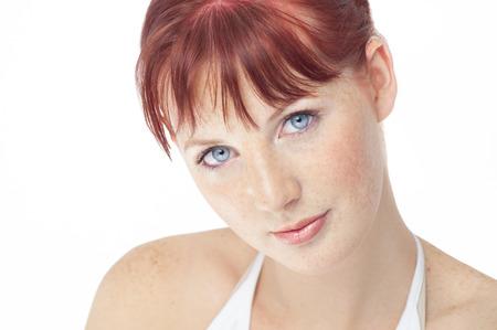 auburn hair: Beautiful fresh Northern European girl with auburn hair, blue eyes and freckles. Stock Photo