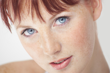 Beautiful fresh Northern European girl with auburn hair, blue eyes and freckles. Stockfoto