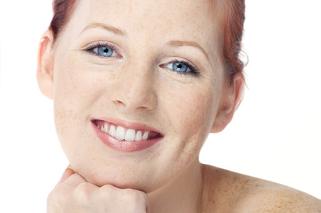 freckles: Beautiful fresh Northern European girl with auburn hair, blue eyes and freckles. Stock Photo