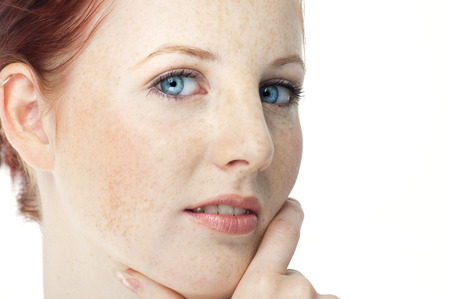 redhaired: Beautiful fresh Northern European girl with auburn hair, blue eyes and freckles. Stock Photo