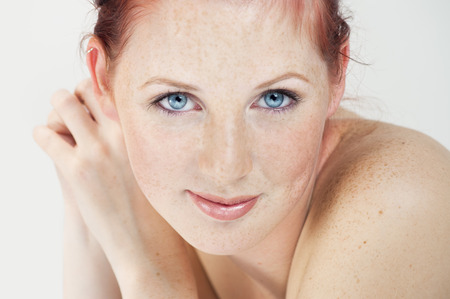 northern european: Beautiful fresh Northern European girl with auburn hair, blue eyes and freckles. Stock Photo