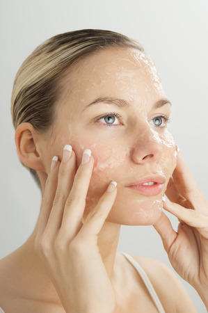 Closeup of young beautiful woman with gel exfoliation mask on face. Stock Photo - 39229380