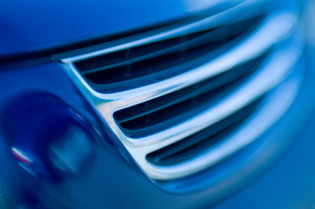 car grill: Abstract shot of a car grill in blue tones.