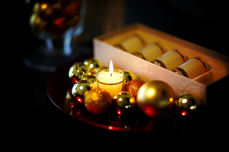 Christmas style composition with balls and candles. photo