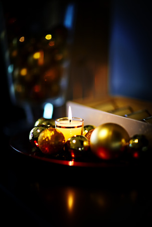 Christmas style composition with balls and candle. photo