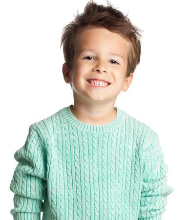 Happy five year old European boy posing over white studio background. Child with big smile. Standard-Bild