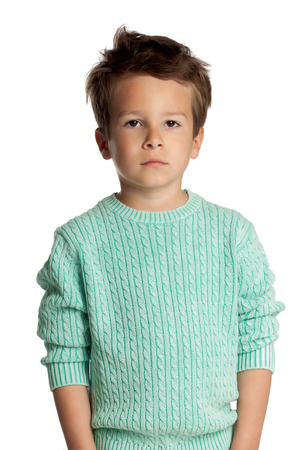 five year old: Stylish five year old European boy posing isolated over white studio background in knitted pullover. Fashion child. Confident little boy.