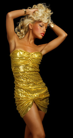gracious: Model dancing in golden dress.
