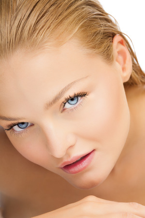 blue eyes: Closeup of beautiful woman with blue eyes. Tanned skin in summer. Smooth young European skin.