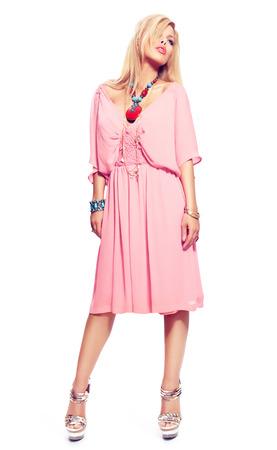 pink posing: Woman posing in light pink dress.