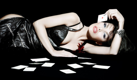 posing: Woman laying down with cards.