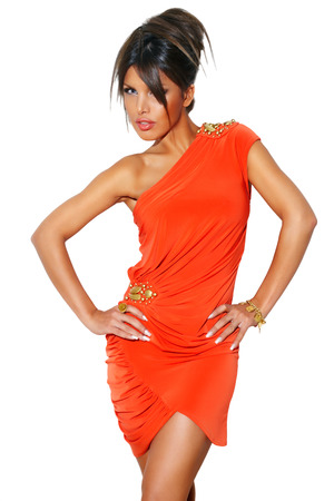 cocktail dress: Model wearing bright coral cocktail dress and golden jewelry.