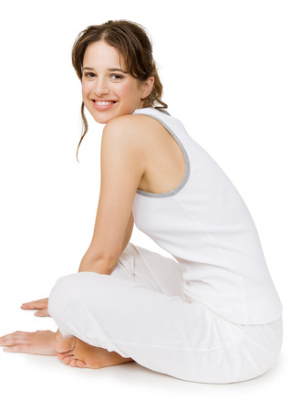 vitality: Beautiful positive fit Caucasian woman resting after workout. Isolated over white background.