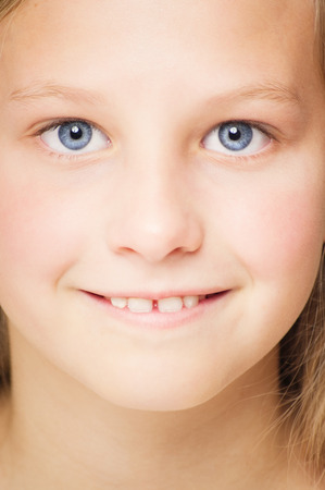 ten year old: Closeup of ten year old happy girl face with bright blue eyes.