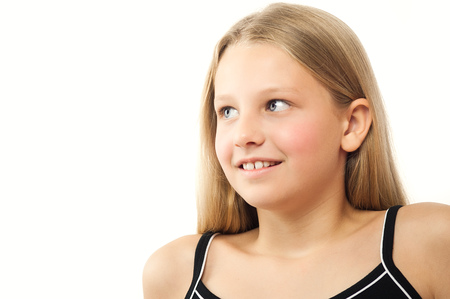 ten year old: Happy ten year old girl Caucasian girl with long blond hair over white background. Stock Photo