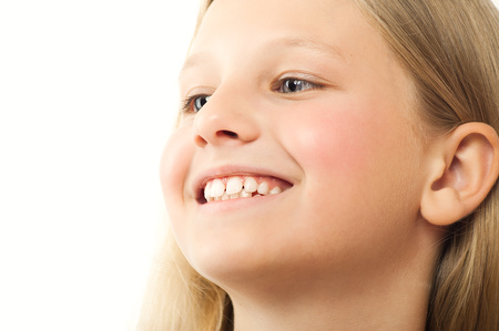 old girl: Happy ten year old girl Caucasian girl with long blond hair over white background. Stock Photo