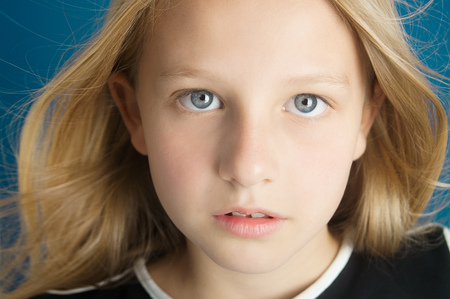 ten year old: Dreamy portrait of a beautiful ten year old girl. Stock Photo