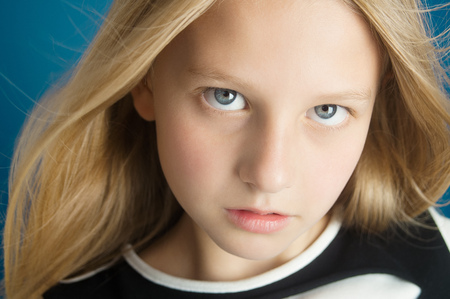 Dreamy portrait of a beautiful ten year old girl with long hair.