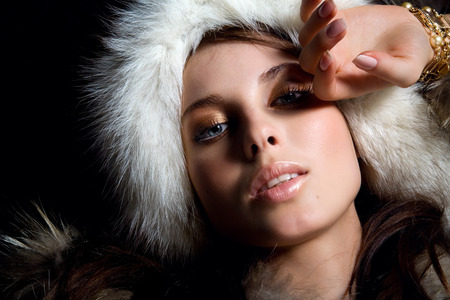 high view: Young woman wearing fur hat.