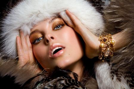 studio photography shot: Model dressed in fur.