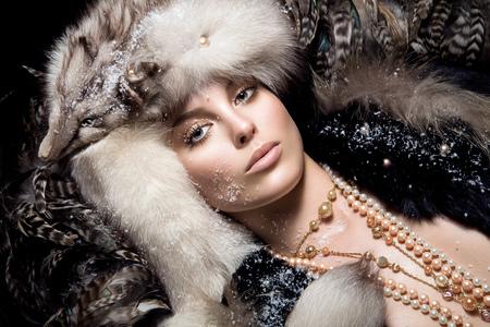 fur: Young woman wearing fur hat.