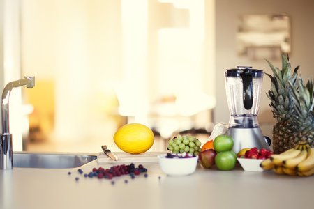 Ingredients for making smoothie in sunny kitchen. Variety of berries and fruit. Standard-Bild