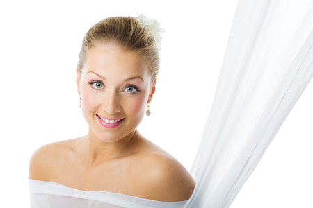 blond girl: Beautiful bride with makeup and gathered hairstyle posing over white background. Bridal makeup in pink tones.