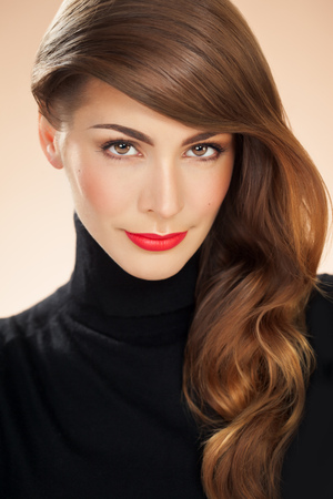 woman eye: Portrait of an American woman with bright red lipstick and long styled hair. Fashion and beauty concept in studio.