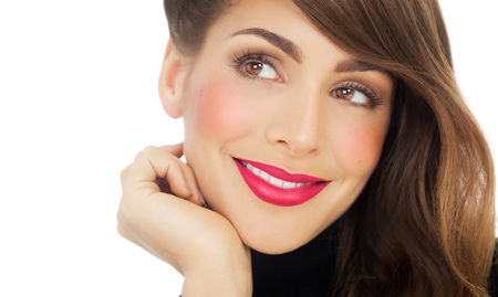 Closeup of a smiling woman with bright pink lipstick. Fashion and beauty concept in studio.