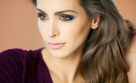 Closeup of a woman with smoky eyes makeup. Fashion and beauty concept in studio. Banco de Imagens