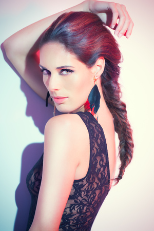 Fashion portrait of a model wearing back lace body. Fashion and beauty concept.