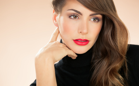 Beautiful American modern woman with red lipstick and black turtleneck pullover.