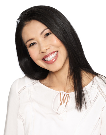 black hair: Enthousiastic happy smilng attractive casual thirty to forty year old Asian woman posing in studio. Stock Photo