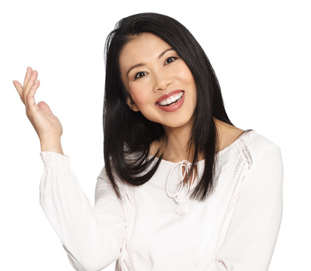 chinese lady: Enthousiastic happy smilng attractive casual thirty to forty year old Asian woman posing in studio. Stock Photo