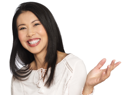30 40: Enthousiastic happy smilng attractive casual thirty to forty year old Asian woman posing in studio. Stock Photo