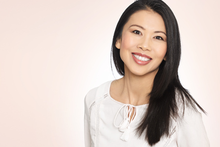 pretty black woman: Enthousiastic happy smilng attractive casual thirty to forty year old Asian woman posing in studio. Stock Photo