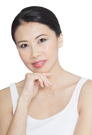 asian natural: Natural casual Asian woman posing over white background. Modern fit thirty or forty year old Chinese woman.