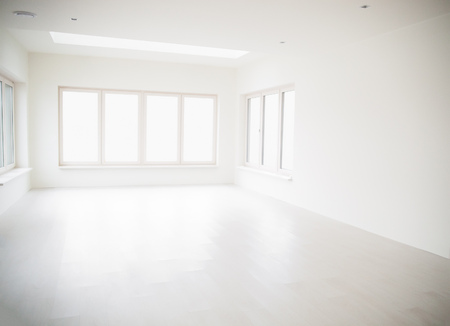 large windows: Empty off-white room with large windows and light wooden floor. Stock Photo