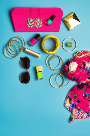 Trendy arranged flat lay fashion and beauty retail products with copyspace.