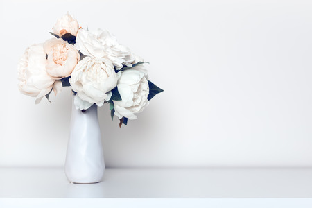 Beautiful peonies bouquet in minimalist indoor setting.