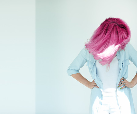 dyed hair: Motion shot of womans hair. Dyed hair in daylight concept. Beautiful woman with copyspace.